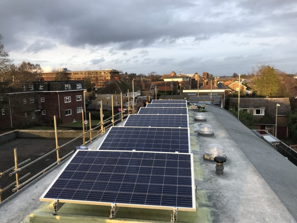 Solar panels on flat roof before final roof coating