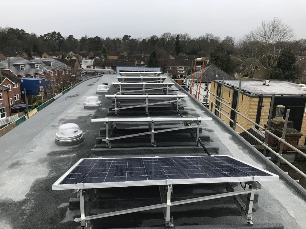 Back view of solar panels on flat roof